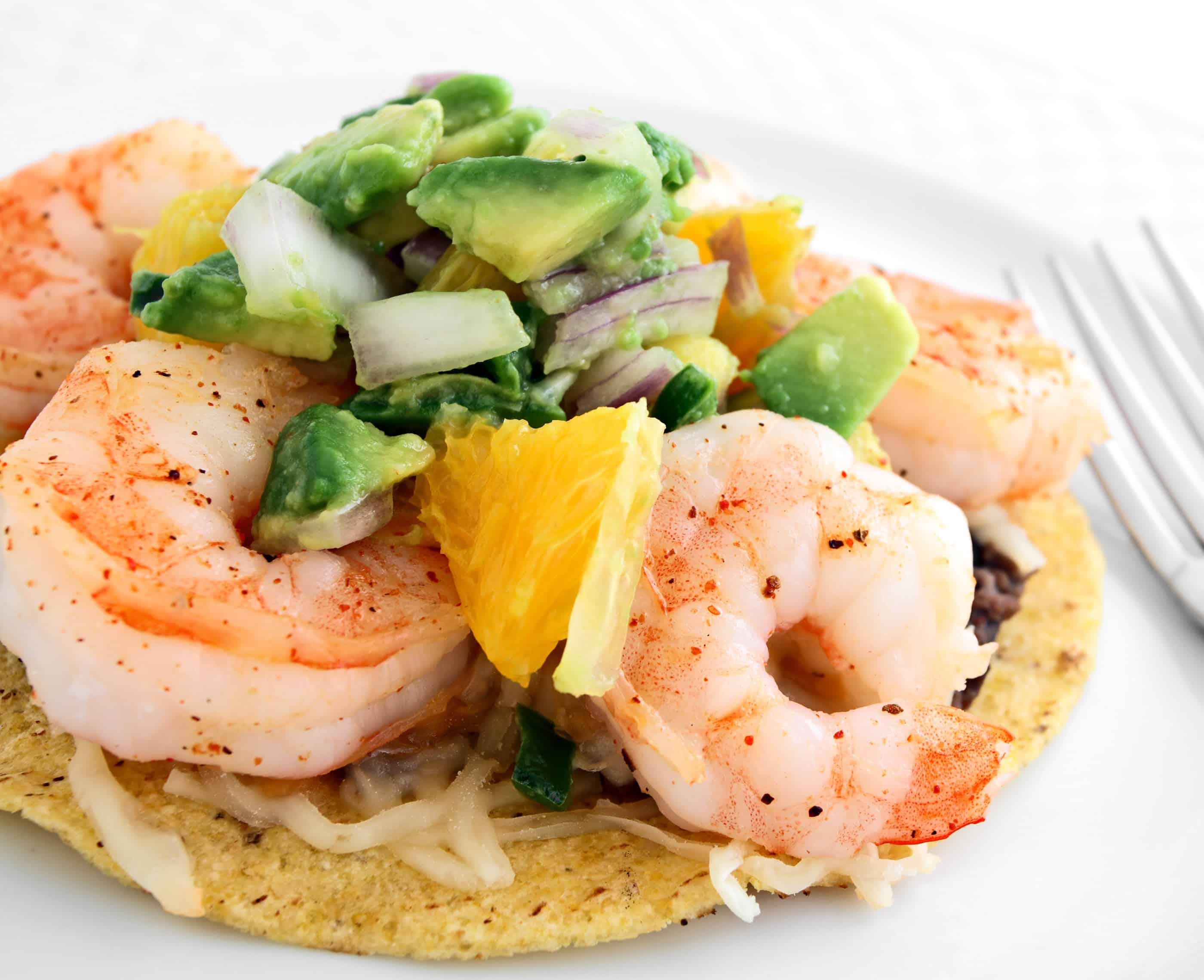 Shrimp tostada with avacodo salsa and refried beans